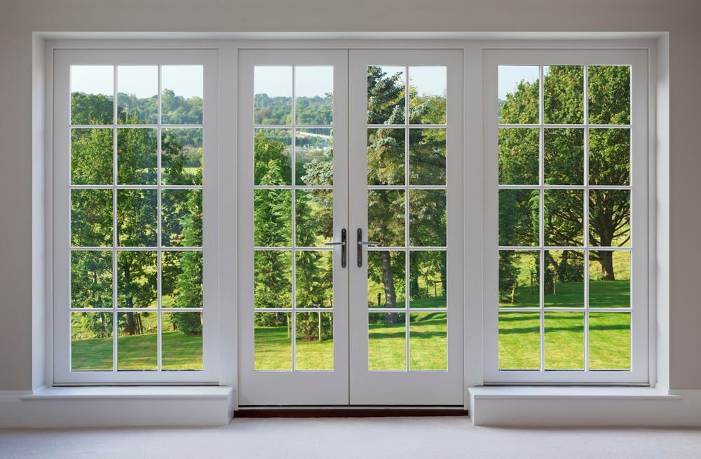 White Two Panel Hinged Patio Door with Door Panel Sidelites with Colonial Grids - Patio