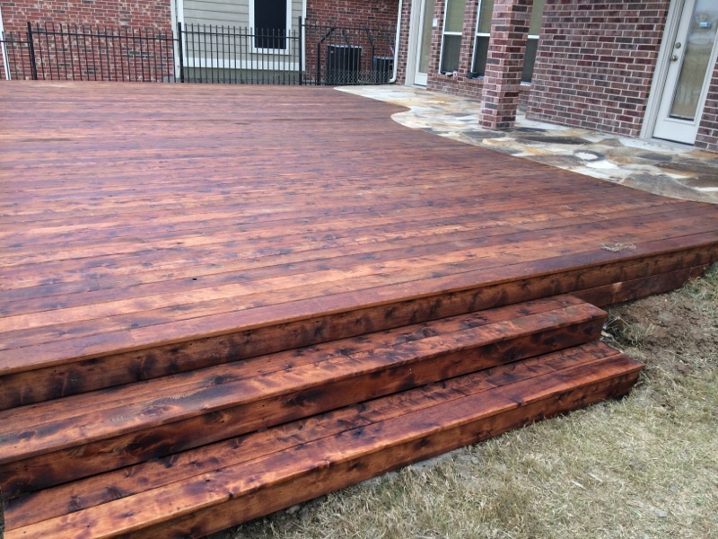 Custom Built Stained Cedar Deck and Stonework - Decks