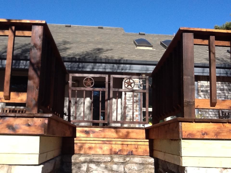 Custom Raised Cedar Deck with Iron Railing - Decks