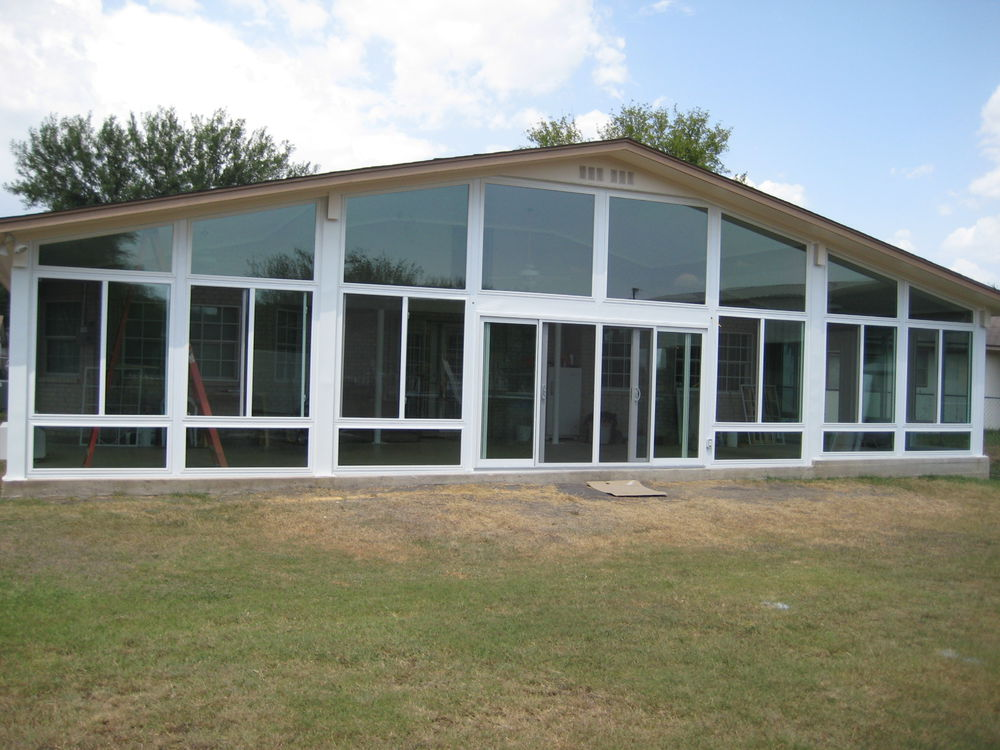 Oversized Sunroom with White Vinyl Replacement Windows - Sunrooms