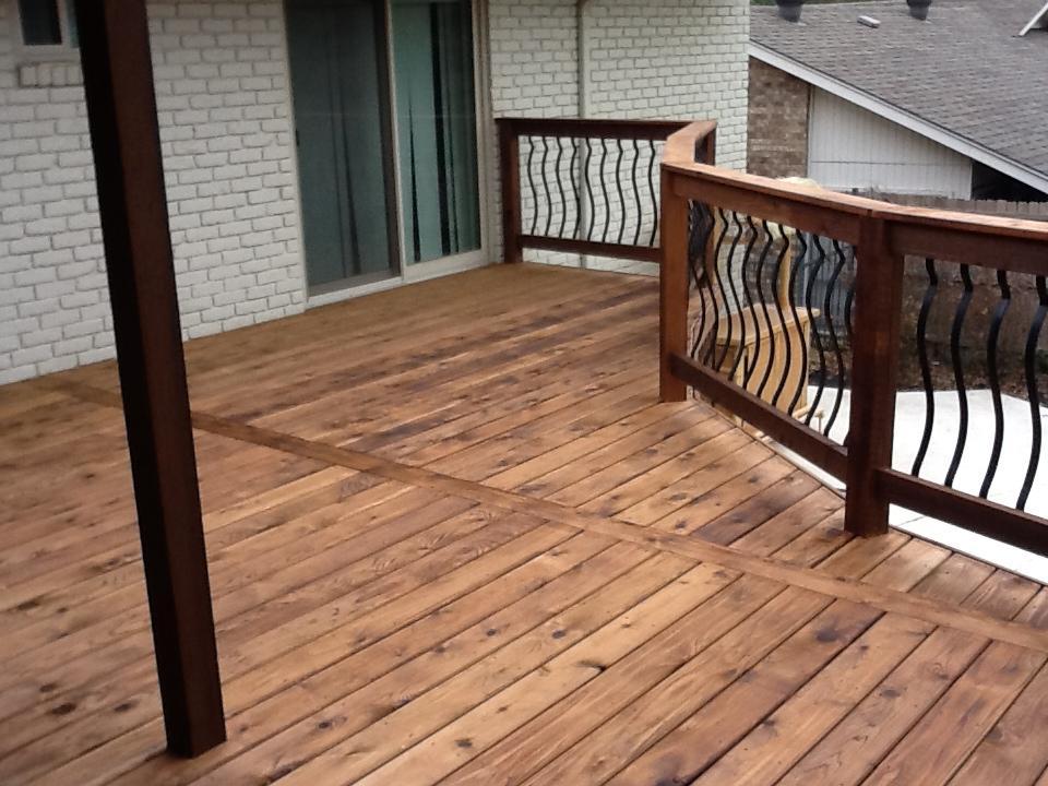 Raised Cedar Smooth Deck with Wrought Iron Railing - Decks