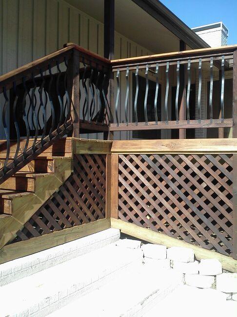 Raised Smooth Cedar Deck with Cedar Lattice Wrought Iron Rail - Decks