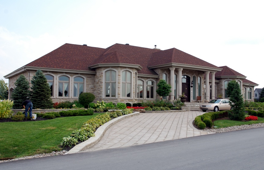 Tan Vinyl Oversized Arched Picture WIndows with Colonial Grids - Picture